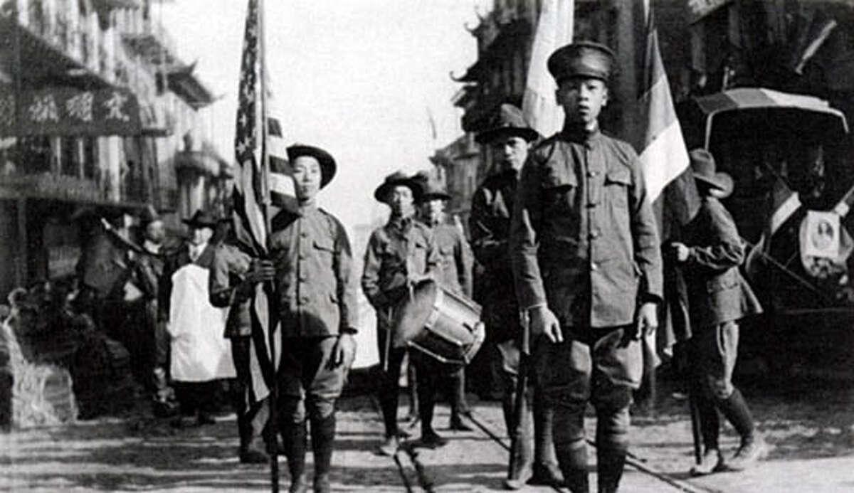 Chinese Boy Scouts parade through Oakland Chinatown circa 1925