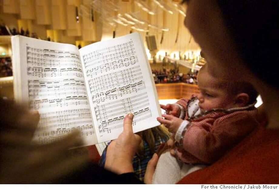 "MESSIAH_01_JMM.JPG  Noa Marvit, 4 months, looks at sheet music with his mom Betsy Marvit during the 27th annual, and last-ever, ""Sing-it-Yourself Messiah"" by George Frederic Handel at the Davies Symphony Hall. Event on 12/2/05 in San Francisco. JAKUB MOSUR / The Chronicle MANDATORY CREDIT FOR PHOTOG AND SF CHRONICLE/ -MAGS OUT Photo: JAKUB MOSUR"
