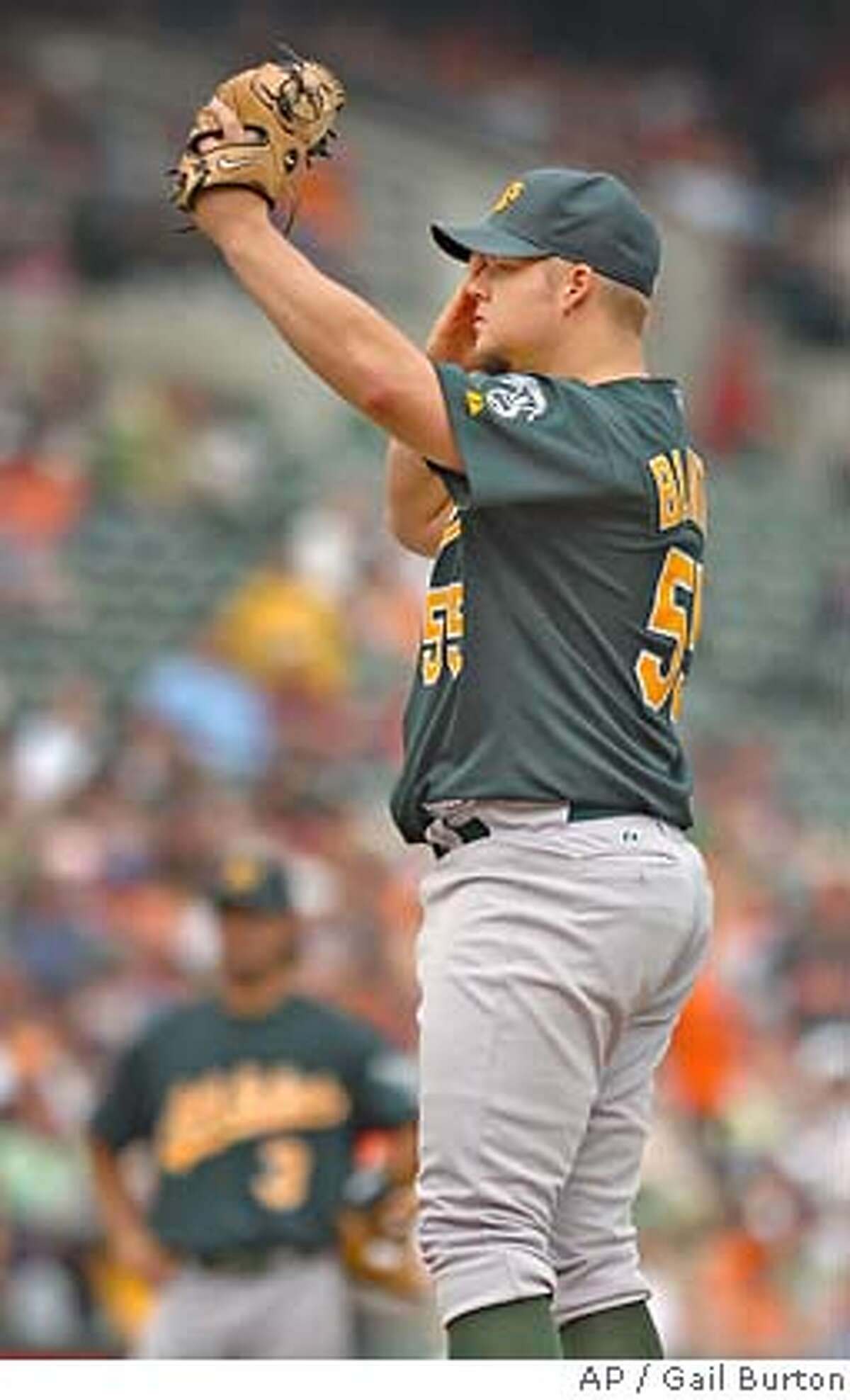Oakland Athletics starting pitcher Joe Blanton wipes his brow after giving up a two-run home run to Baltimore Orioles' Melvin Mora in the fourth inning of a baseball game Sunday, May 27, 2007, in Baltimore. The Orioles won 8-4.(AP Photo/Gail Burton)