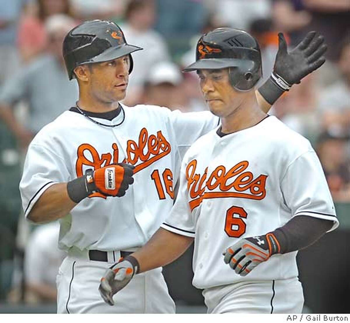 Baltimore Oriole's Jay Payton, left, congratulates Melvin Mora after Mora's two-run home run off Oakland Athletics' Joe Blanton in the fourth inning of a baseball game Sunday, May 27, 2007, in Baltimore.(AP Photo/Gail Burton)