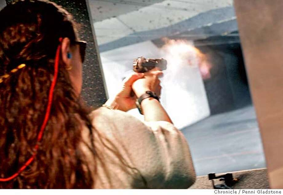 HANDGUN05_0155_PG.JPG Margaret shoots her pistol at the Bullseye Range in San Rafael.  Margaret lives with her partner B.C. in an apartment in the Mission, just blocks away from turf that is rampant with gang activity. So the 49-year-old UCSF office worker bought a handgun for her protection. And she says she is not afraid to use it. This is not your typical card-carrying NRA member. In fact, the Briton native grew up in a society that was practically gun free. But the recent passage of San Francisco�s Prop H, which would make it illegal for people to possess handguns in the city, has her fuming. She is refusing to give up her gun if the law takes effect, simply because she feels it will put her life in danger. Photo taken by Penni Gladstone/The San Francisco Chronicle  Photo taken on 12/4/05, in San Rafael, CA. MANDATORY CREDIT FOR PHOTOG AND SF CHRONICLE/ -MAGS OUT Photo: Penni Gladstone