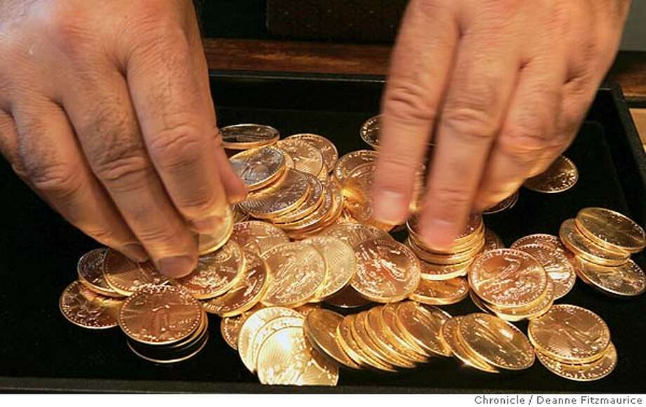gold04_022_df.JPG  Allen is counting American Eagle gold coins. The price of gold is at a 20 year high. Allen Notowitz is the President of Numis International Inc. in Millbrae.  Event in Millbrae on 12/31/05.  Deanne Fitzmaurice / The Chronicle Photo: Deanne Fitzmaurice