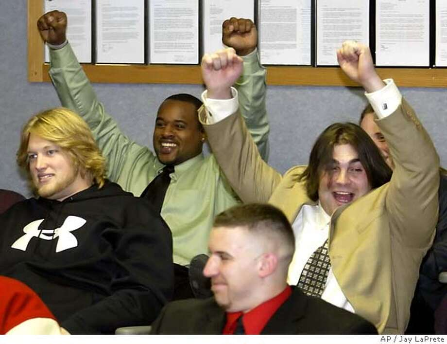 Ohio State players Marcus Green, top left, and Anthony Schlegel, right, celebrate during a news conference Sunday Dec. 4, 2005, in Columbus, Ohio after hearing they will be playing Notre Dame in the Fiesta Bowl, Jan 2, 2006 in Tempe, Ariz.. Sitting in front of them are Nick Mangold, left, and Mike Kudla. (AP Photo/Jay LaPrete) Photo: JAY LAPRETE