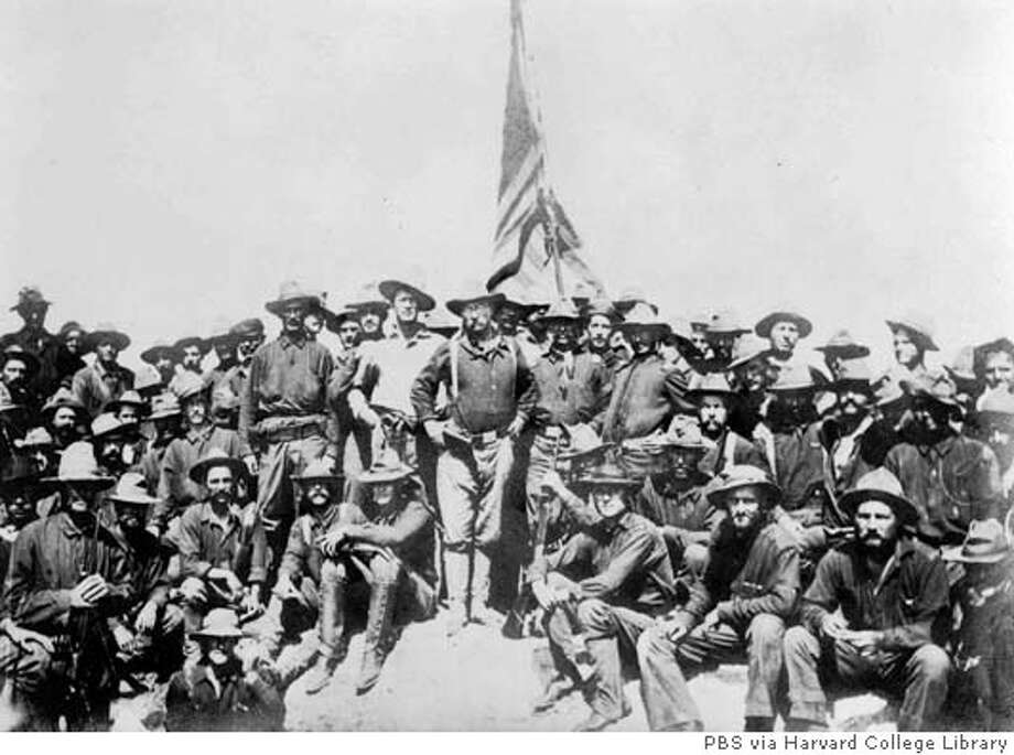 "Theodore Roosevelt stands at the center of his First Volunteer Cavalry Unit, a k a the Rough Riders, who made the legendary charge up Cuba's San Juan Ridge during the Spanish-American War in 1898. The future president's role in the war is featured in ""Crucible of Empire: The Spanish -American War,"" which premieres on PBS Aug. 23 at 9 p.m., EDT. (AP Photo/PBS via Harvard College Library) Photo: Unknown"