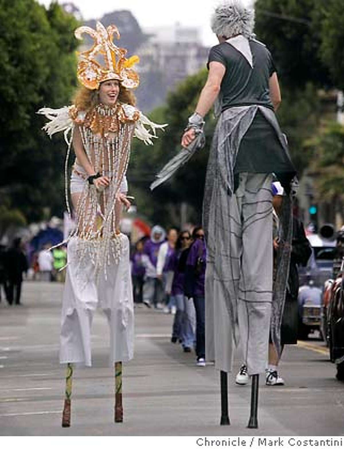 Stilted dancers on 24th St. at the annual parade held in the Mission district PHOTO: Mark Costantini / The Chronicle