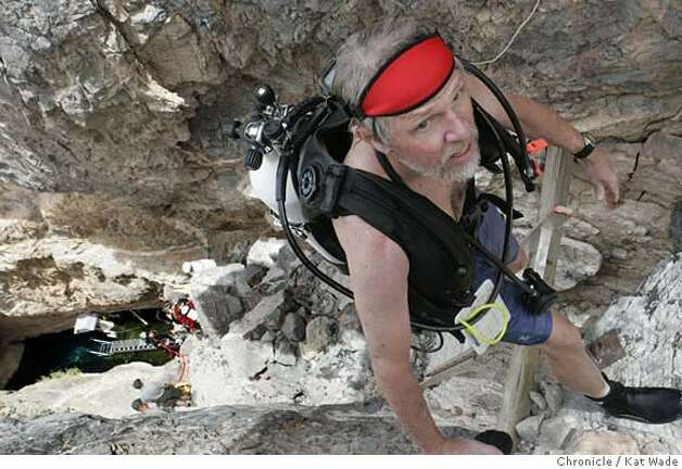 PUPFISH_0462_KW.JPG  biologist, Dr. Stan Hillyard climbs the steep cliff from Devil's Hole 80 feet below completely outfitted in SCUBA gear after the second dive when scientists and National Park certified divers do the annual count of the Devil's Hole desert pupfish in the Mojave Desert at Ash Meadows of the Amargosa Valley just west of Pahrump, Nevada is in the largest oasis in the desert on April 14, 2007. The Devil's Hole pupfish are the most endangered of the desert pupfish and the unofficial count at the end of the day was 38.  Kat Wade/The Chronicle  Dr. Stan Hillyard(CQ, subject) Photo: Kat Wade