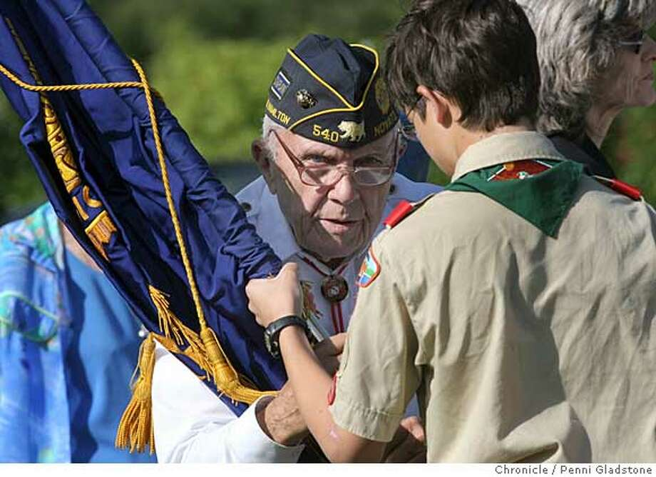 Ted McCarthy with American Legion Post 540 Novato helps unroll a flag with the help of a boy scout. This took place at the Valley Memorial Park in Novato as part of Memorial day on May 28, 2007. In attendence were local boyscouts, & veterans and people who wanted to pay their respects.  Event on 5/28/07 in Novato.  penni gladstone / The Chronicle Photo: Penni Gladstone
