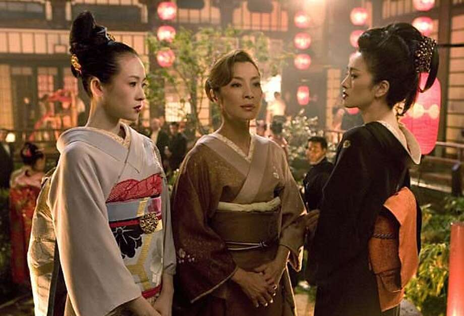 """In this photo released by Edko Films Ltd, the movie scene shows Chinese actress Zhang Ziyi, from left, Hong Kong actress Michelle Yeoh and Chinese actress Gong Li acting at their new movie """"Memoirs Of A Geisha"""". The movie is expected to show on screen on Christmas. (AP/Edko Films Ltd) STAND ALONE PHOTO NO ARCHIVES Photo: Edko Films Ltd"""