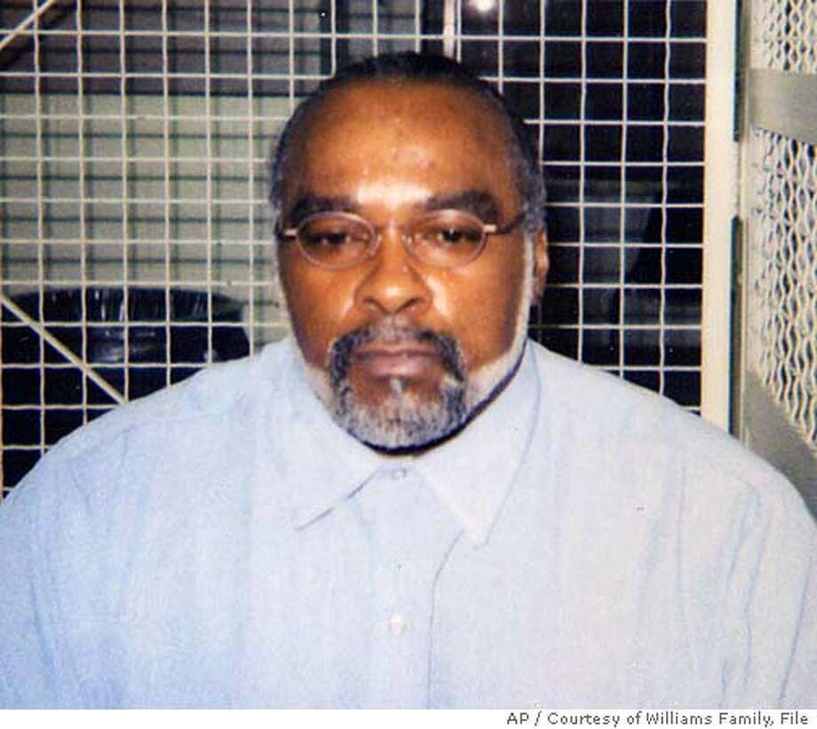 """** ADVANCE FOR SUNDAY, DEC. 4 ** FILE ** In this undated photo provided by his family, Stanley """"Tookie"""" Williams poses in the visiting area of San Quentin State Prison in California. Williams was convicted and sentenced to death for the 1979 murders of four people during two robberies in Los Angeles. He claims he didn't commit the crimes, but he acknowledges the harm caused by the Crips. He says he's relinguished his gangster past and is a changed man. (AP Photo/Courtesty of Williams Family, File) Ran on: 12-01-2005 Ran on: 12-01-2005  Stanley Tookie Williams' fate is now in the hands of Gov. Arnold Schwarz- enegger. Ran on: 12-02-2005  &quo;It is absurd for a person to apologize for some- thing he didn't do. I will not lower my integrity. It would be wrong.&quo; Stanley Tookie Williams Ran on: 12-02-2005  &quo;It is absurd for a person to apologize for some- thing he didn't do. I will not lower my integrity. It would be wrong.&quo; Stanley Tookie Williams ADVANCE FOR SUNDAY, DEC. 4. UNDATED PHOTO Photo: File"""