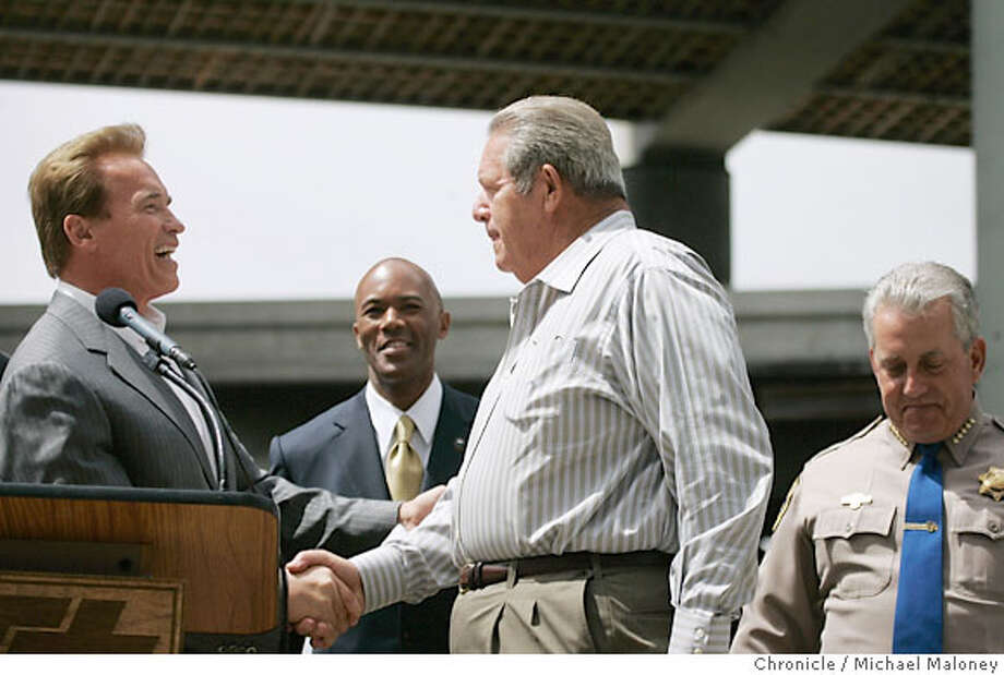 Governor Arnold Schwarzenegger (left) congratulates Clinton C. Meyers CEO of C.C. Meyers Inc. for his company's quick work. In the center is Dale Bonner, secretary of the Business, Transportation and Housing Agency and at far right, Mike Brown, commissioner of the California Highway Patrol.  Governor Arnold Schwarzenegger held a press conference Friday morning to announce the repairs to the MacArthur maze and reopening of the freeway for the Friday commute.  The I-580 connector in Oakland opened at 8:40 p.m. Thursday, in plenty of time for Friday morning's commute. The connector had been shut down when a tanker fire collapsed part of the MacArthur maze less than one month ago.  Photo by Michael Maloney / San Francisco Chronicle Photo taken on 5/25/07 in OAKLAND, CA  ***Clinton C. Meyers, Arnold Schwarzenegger, Dale Bonner, Mike Brown Photo: Michael Maloney