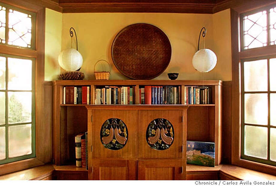 SIGSTYLE10-A_104_CG.JPG  A built-in bookshelf and entertainment center in the home of Walther Steilberg, in Berkeley, Ca., shown here on Wednesday, November 16, 2005. We are doing a story in our Signature Style series on Berkeley architect Walter Steilberg. Renata Polt and her husband Fred Schmitt have a house designed by Steilberg, who died in 1974 with Chinese tiles all over (especially the balcony), also a wonderful living room with vaulted ceiling and a very unusual pattern of redwood beams. In addition, they have original Chinese hanging silk lanterns, a distinctive Steilberg touch. Also, Chinese chair backs as grills in the dining nook pass-through to kitchen. Photo by Carlos Avila Gonzalez / The San Francisco Chronicle  Photo taken on 11/16/05 in Berkeley, CA. MANDATORY CREDIT FOR PHOTOG AND SAN FRANCISCO CHRONICLE/ -MAGS OUT Photo: Carlos Avila Gonzalez