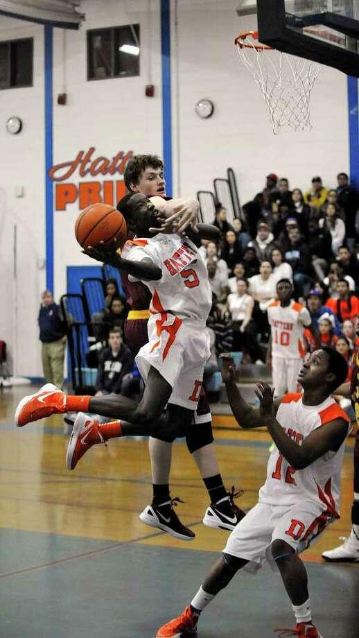 St. Joseph's Patrick Hopkins tries to block Danbury's C.J. White's shot during their game at Danbury High School on Tuesday, Jan. 17, 2012. St. Joseph won 84-66. Photo: Jason Rearick / The News-Times