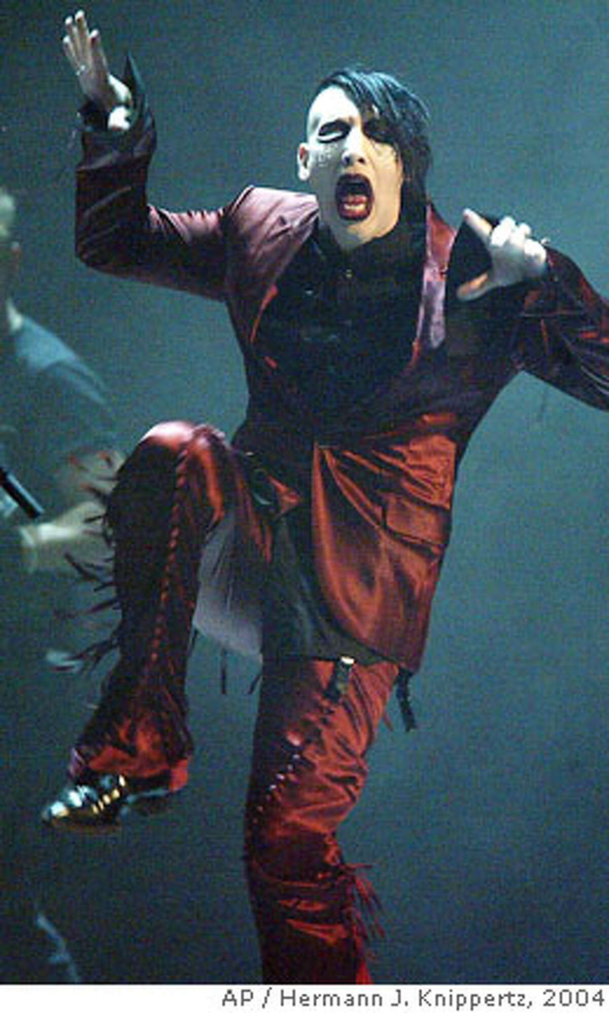 Rock star Marilyn Manson performs at the Koelnarena in Cologne, western Germany, Friday, Sept. 24, 2004, during the entertainment part of the Comet German music award ceremonies. (AP Photo/Hermann J. Knippertz) Ran on: 10-01-2004 Marilyn Manson will be at the Warfield Nov. 1.