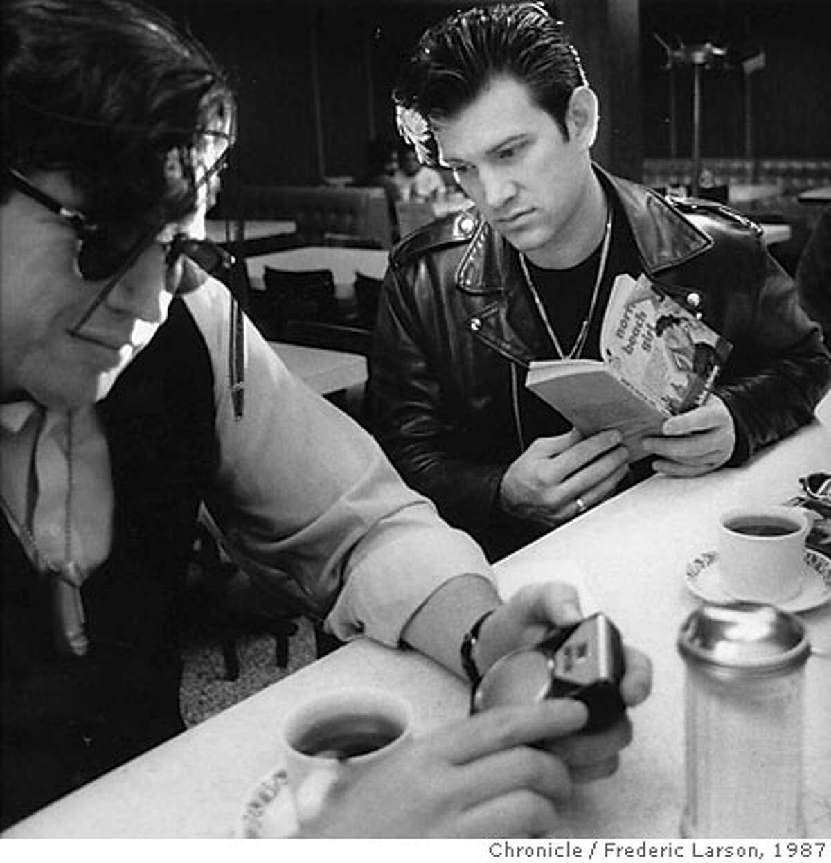 CHRIS ISAAK AND HIS OWN LOOK OF FASHION WITH DRUMMER KENNY DALE JOHNSON AT LEFT. SHOT ON LOCATION IN CHINATOWN