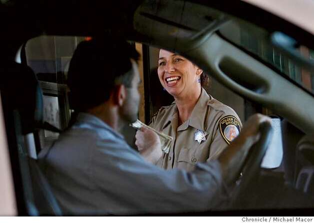 goldengatebridge3_053_mac.jpg Toll Officer, Michelle Shalagin has collected tolls on the Golden Gate Bridge for the past 13 years. The Golden Gate Bridge set to turn 70 years old on Sunday May 27th. Photographed in, San Francisco, Ca, on 5/23/07. Photo by: Michael Macor/ The Chronicle Photo: Michael Macor