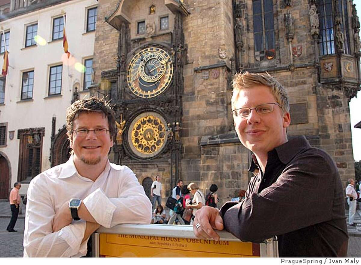 Caption: San Francisco Symphony violinist Dan Carlson and oboist Jonathan Fischer in front of the Town Hall Astronomical Clock in Prague, during their visit as part of the San Francisco Symphony�s European tour. Credit: Photo@PragueSpring �Ivan Maly