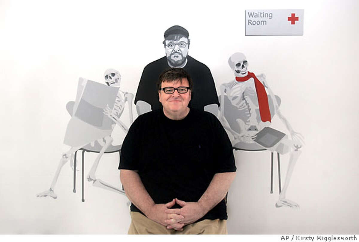 """American director Michael Moore poses for a portrait at the 60th International film festival in Cannes, southern France, on Monday, May 21, 2007. Michael Moore's new film """"Sicko,"""" premiered at the festival on Saturday, May 19, 2007. (AP Photo/Kirsty Wigglesworth)"""
