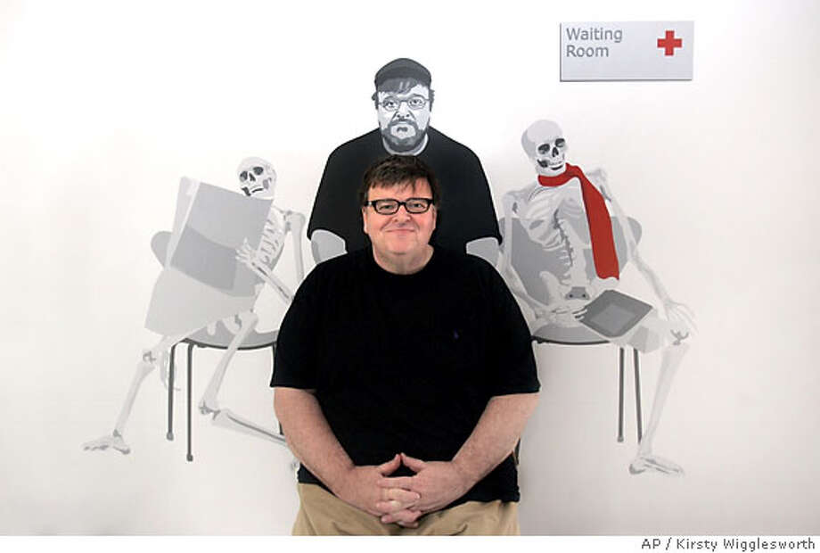 """American director Michael Moore poses for a portrait at the 60th International film festival in Cannes, southern France, on Monday, May 21, 2007. Michael Moore's new film """"Sicko,"""" premiered at the festival on Saturday, May 19, 2007. (AP Photo/Kirsty Wigglesworth) Photo: Kirsty Wigglesworth"""