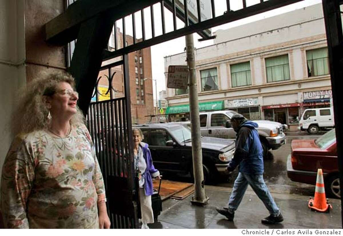 NIMBY02_003_CAG.JPG Antoinetta Stadlman stands looking out the doorway of her home on 6th Street in San Francisco, Ca., on Thursday, December 1, 2005. Residents living near the intersection of Howard and Sixth Streets experience plenty of urban grit. The neighborhood is home to formerly homeless seniors, hundreds of SRO hotel tenants and plenty of registered sex offenders. Drug dealing and prostitution are just part of the scenery. So, when the city proposed rebuilding the aging Plaza Hotel and making it low-income housing, neighbors laid out the welcome mat. Now, however, things have changed. Under a cutting edge homeless housing initiative that has been billed as a national model, the city wants to use the hotel to house chronically homeless people who were kicked out of shelters because they are too violent or unstable. Neighbors are saying no thanks. Antoinetta Stadlman is one of those neighbors. She lives in an SRO hotel just about a block away from the new housing for the homeless. Photo by Carlos Avila Gonzalez / The San Francisco Chronicle Photo taken on 12/1/05 in San Francisco, CA. MANDATORY CREDIT FOR PHOTOG AND SAN FRANCISCO CHRONICLE/ -MAGS OUT