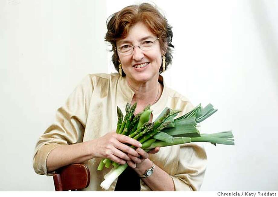 "KINGSOLVER27_030_RAD.jpg SHOWN: Barbara Kingsolver poses for a portrait at Zuni Cafe with a bunch of local vegetables from the kitchen: asparagus, fava beans, and leeks. Barbara Kingsolver and her husband Steven L. Hopps enjoyed lunch at Zuni Cafe in San FRancisco. Barbara Kingsolver has just published a book called ""Animal, Vegetable, Miracle A Year of Food Life."" These pictures were made in San Francisco, CA. on Tuesday, May 15, 2007.  (Katy RaddatzThe Chronicle)  **Barbara Kingsolver, Steven L. Hopps  Ran on: 05-27-2007  Barbara Kingsolver and family spent a year eating mostly what they grew.  Ran on: 05-27-2007 Photo: Katy Raddatz"