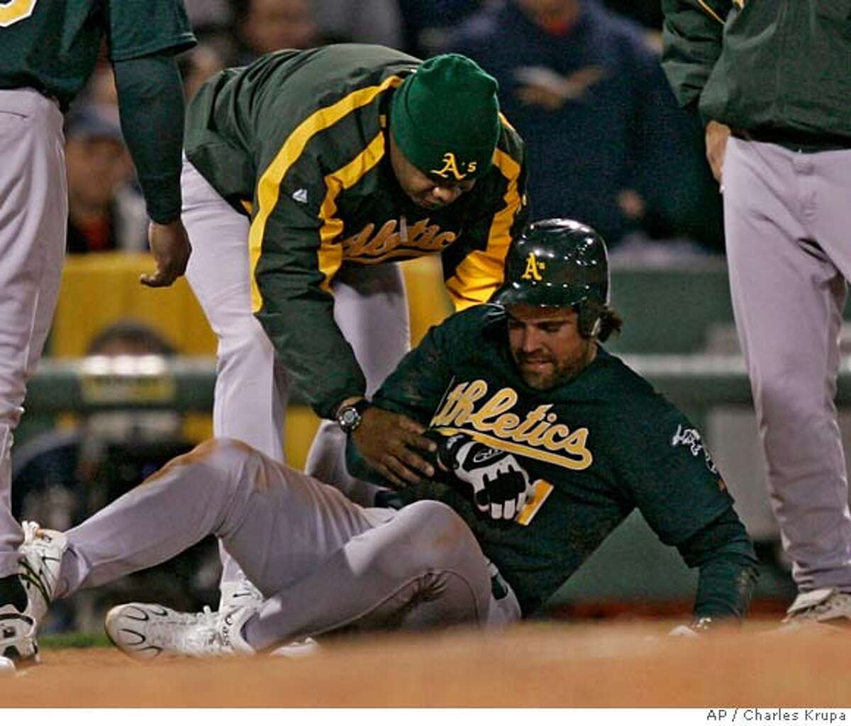 Oakland Athletics' Mike Piazza is helped up after Boston Red Sox third baseman Mike Lowell fell on him in the sixth inning during their baseball game in Boston Wednesday, May 2, 2007.(AP Photo/Charles Krupa) Ran on: 05-03-2007 Mark Ellis throw was too late to get Jason Varitek in the second inning. Ran on: 05-03-2007 Mike Piazza on his sprained AC joint: Its the second-worst thing you can do to your shoulder. Ran on: 05-03-2007 Mike Piazza on his sprained AC joint: Its the second-worst thing you can do to your shoulder.