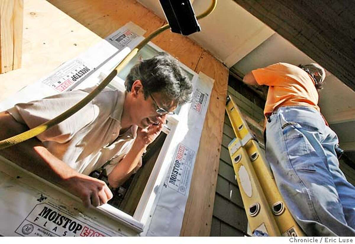 homeowner_contractors_194.JPG Michel takes a cell phone call while his carpenter/helper Marcos Hau installs earthquaking straps for an inspection that is happening the next day. Homeowner Michel Del Buono is in the middle of a large remodel job at his home in Palo Alto while working full time. Photographer: Eric Luse / The Chronicle names (cq) from source Michel Del Buono Marcos Hau MANDATORY CREDIT FOR PHOTOG AND SF CHRONICLE/NO SALES-MAGS OUT
