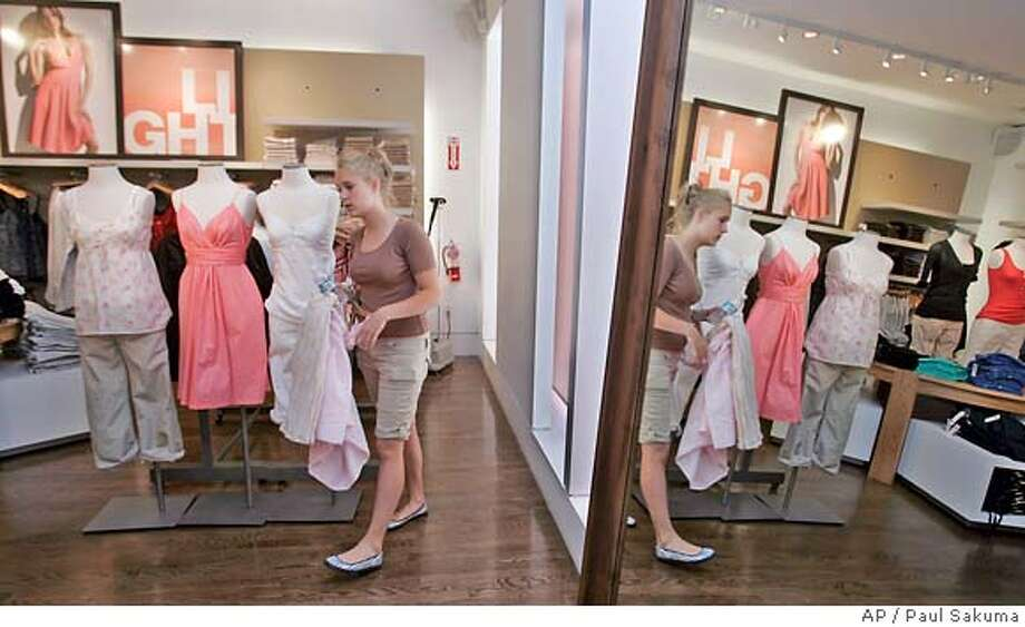 A customer shops at a Gap store in Palo Alto, Calif., Wednesday, May 23, 2007. Gap Inc. is expected to release quarterly earnings Thursday, May 24, 2007. (AP Photo/Paul Sakuma) Photo: Paul Sakuma