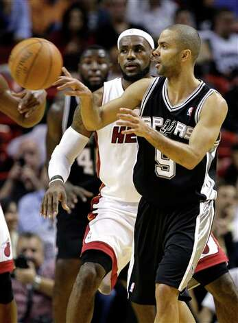 San Antonio Spurs' Tony Parker (9) passes the ball as Miami Heat's LeBron James, left, looks on during the first half of an NBA basketball game, Tuesday, Jan. 17, 2012, in Miami. (AP Photo/Lynne Sladky) Photo: Associated Press