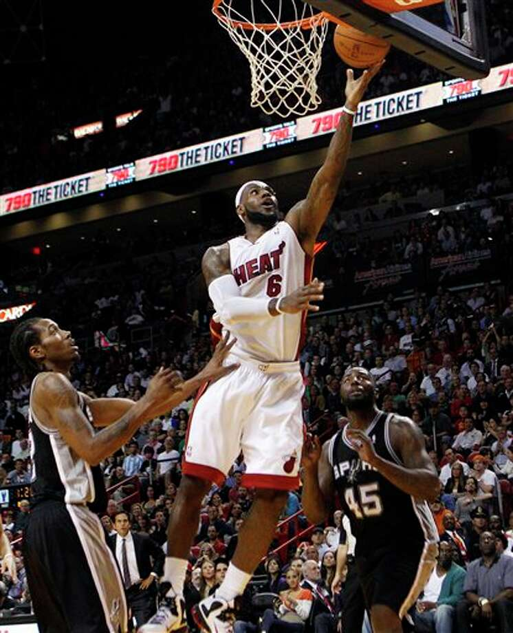 Miami Heat's LeBron James (6) shoots over San Antonio Spurs' Kawhi Leonard (2) and DeJuan Blair (45) during the first half of an NBA basketball game, Tuesday, Jan. 17, 2012, in Miami. (AP Photo/Lynne Sladky) Photo: Associated Press