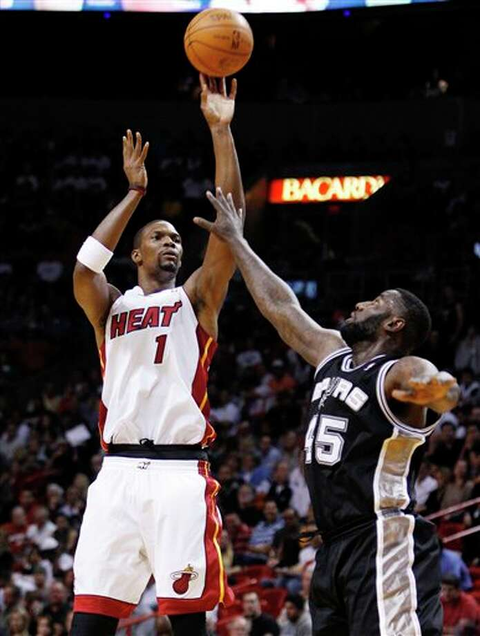 Miami Heat's Chris Bosh (1) shoots as San Antonio Spurs' DeJuan Blair (45) defends during the first half of an NBA basketball game, Tuesday, Jan. 17, 2012, in Miami. (AP Photo/Lynne Sladky) Photo: Associated Press