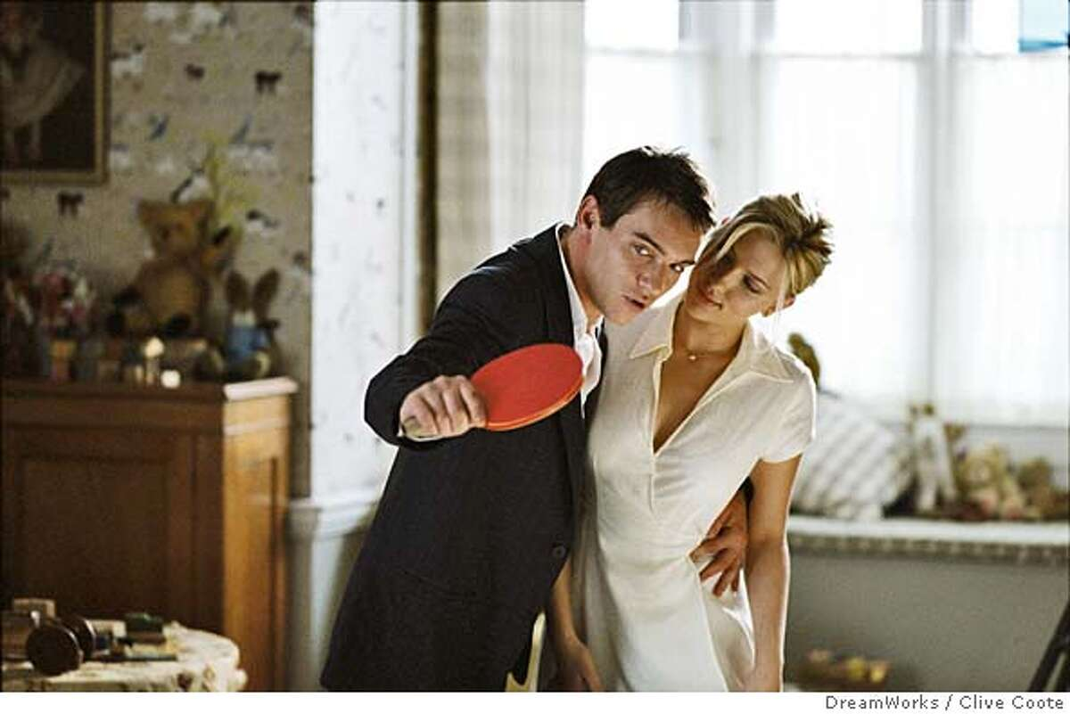 Tennis pro Chris Wilton (JONATHAN RHYS MEYERS) gives Nola Rice (SCARLETT JOHANSSON) a ping-pong lesson in Woody Allen�s new dramatic thriller MATCH POINT to be distributed domestically by DreamWorks. Photo by Clive Coote