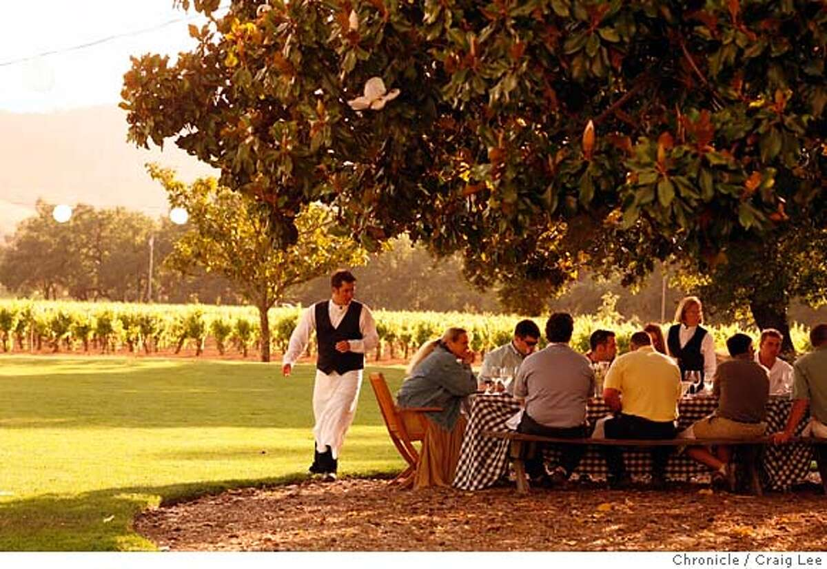 winepicnics25_347_cl.JPG Story on wineries that have picnic areas. This is the picnic area at Chateau St. Jean in Kenwood. Photo of a company from Nashville, Tennessee, Lipman Brothers, having a catered picnic. Event on 5/17/07 in Kenwood. photo by Craig Lee / The Chronicle MANDATORY CREDIT FOR PHOTOG AND SF CHRONICLE/NO SALES-MAGS OUT