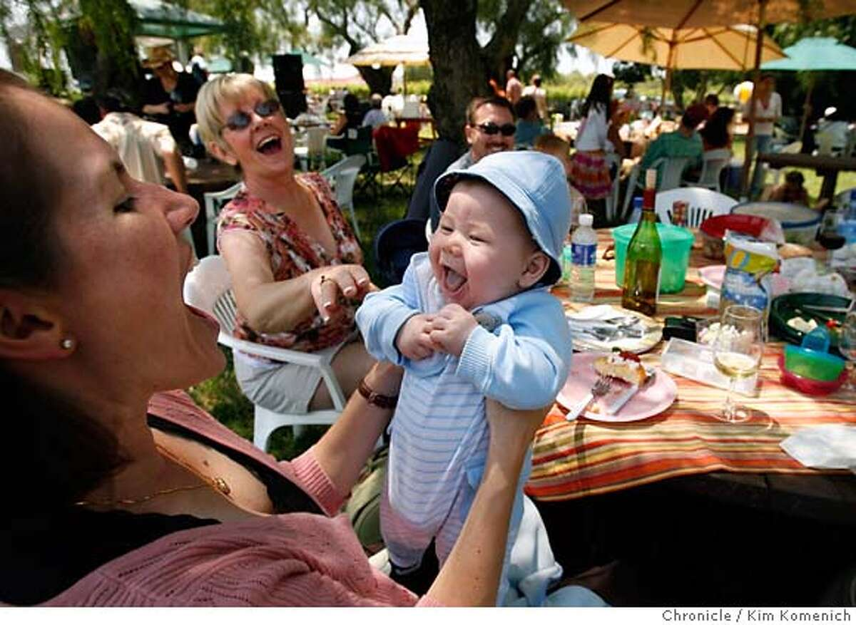 """WINEPICNICS25_100_KK.JPG Heather Houston of Dublin holds son Noah, 5 mos., as Kathy McNichols of Pittsburg reacts during a picnic at Retzlaff Vineyards in Livermore. Some Livermore Valley wineries allow and even encourage """"wine picnics"""". We visit Retzlaff Vineyards, Wente Vineyards Estate Winery, Concannon VIneyard and Fenestra Winery Photo by Kim Komenich/The Chronicle **Heather Houston, Noah Houston Kathy McNichols �2007, San Francisco Chronicle/ Kim Komenich MANDATORY CREDIT FOR PHOTOG AND SAN FRANCISCO CHRONICLE. NO SALES- MAGS OUT."""