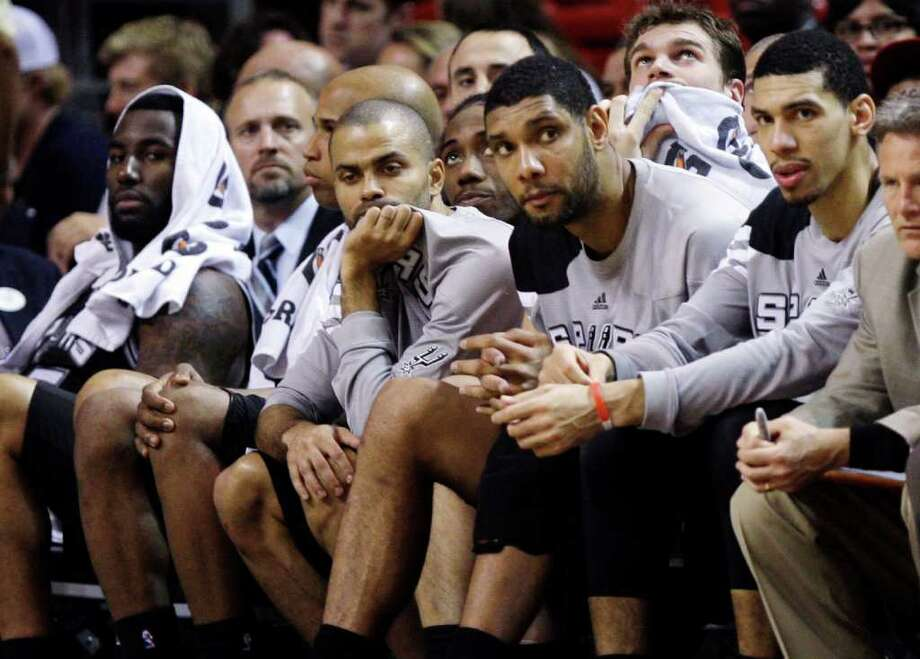 DeJuan Blair (from left), Richard Jefferson, Tony Parker, Tim Duncan and Danny Green watch from the Spur's bench as the Heat wrap up their come-from-behind win. Photo: AP