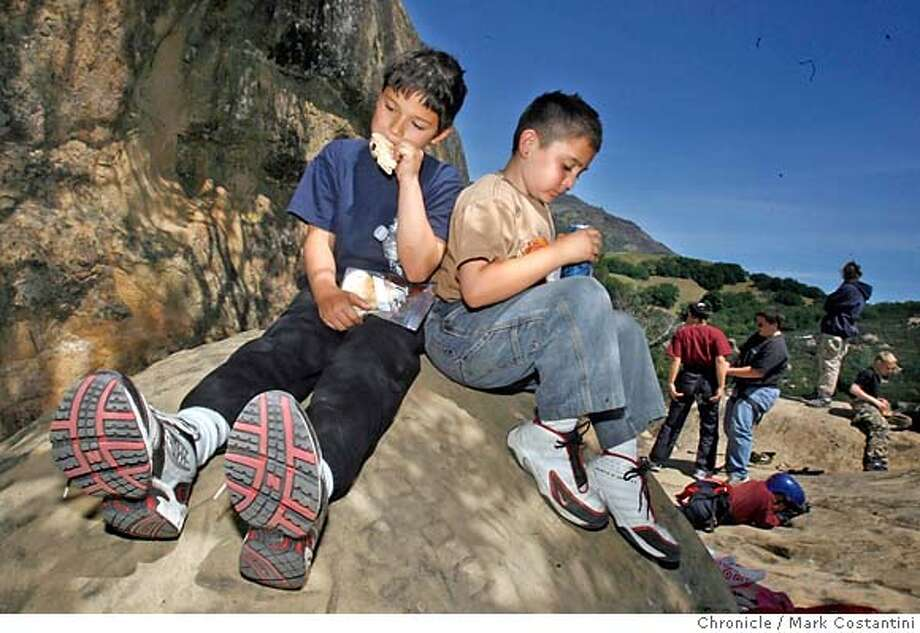 Velamir Petrovic, 9, (left) and Chrisitan Brown, 7, picnic after rock climbing.  This is for the Food special issue on best Bay Area picnic sites. Photographs of a Stockton based martial arts class picnicking Mt Diablo State Park at the Rock City Picnic Area, PHOTO: Mark Costantini / The Chronicle MANDATORY CREDIT FOR PHOTOGRAPHER AND SAN FRANCISCO CHRONICLE/NO SALES-MAGS OUT Photo: MARK COSTANTINI