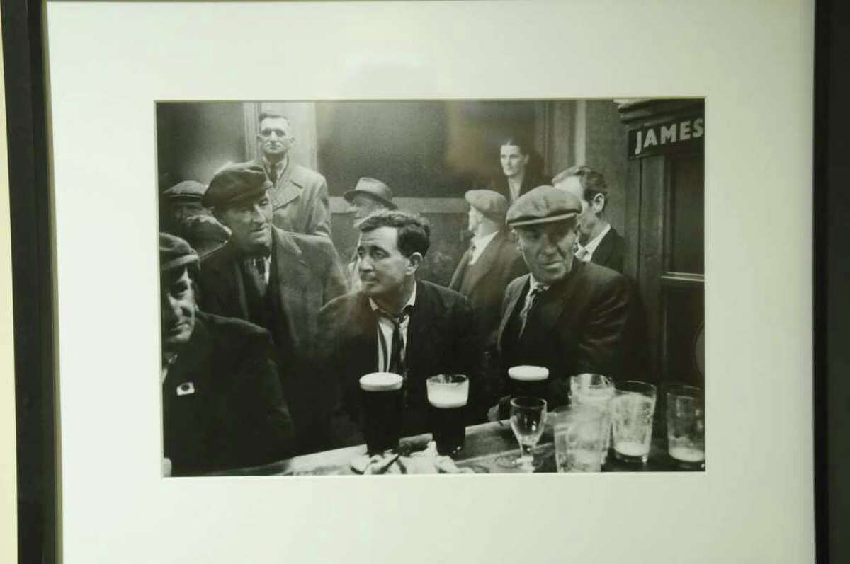 A photograph from a pub in Ireland from 1963 by American photographer Marvin Koner is seen on display during the ribbon cutting ceremony for the Irish American Heritage Museum on Tuesday, Jan. 17, 2012 in Albany, NY. The museum located at 370 Broadway in the city occupies a 3,000-square-foot space in the historic Meginniss Building. The exhibit up is entitled