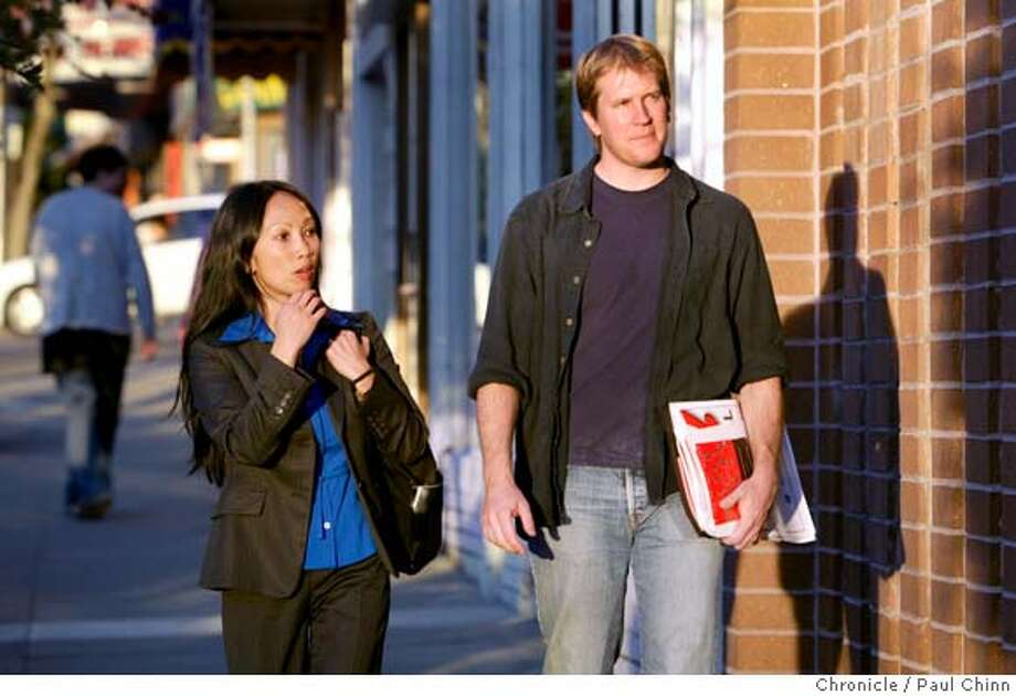 "buylocal29_048_pc.jpg  Don Shaffer (right) of the Business Alliance for Local Living Economies and Agnes Briones from the city's Small Business Commission visit local businesses on West Portal Avenue to encourage participation in a ""Shop Local First"" campaign on 11/17/05 in San Francisco, Calif.  PAUL CHINN/The Chronicle MANDATORY CREDIT FOR PHOTOG AND S.F. CHRONICLE/ - MAGS OUT Photo: PAUL CHINN"