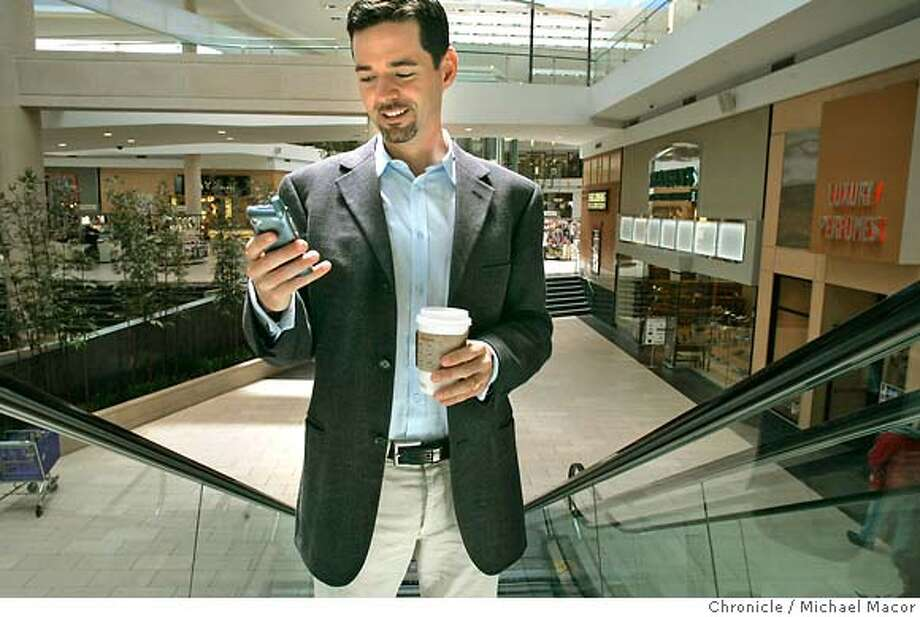 nearbynow_050_mac.jpg Dunlap demonstrates the mobile option of searching for items at stores,inside the mall on his PDA/phone while at Eastridge Mall in San Jose. Scott Dunlap is the CEO and President of NearbyNow. NearbyNow, based in Mountain View, has come up with technology that allows shoppers to browse products, brands, and sales available at local shopping centers using the Internet or cell phones. Photographed in, San Jose, Ca, on 5/15/07. Photo by: Michael Macor/ The Chronicle Mandatory credit for Photographer and San Francisco Chronicle No sales/ Magazines Out Photo: Michael Macor