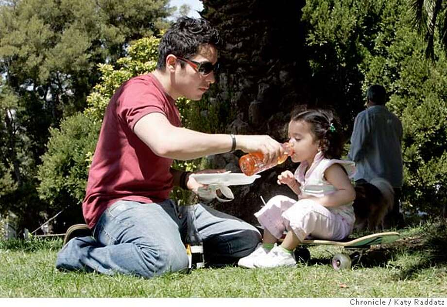 PICNIC23_DOLORES_041_RAD.jpg SHOWN: Raul Aban makes sure his 2-and-a-half-year-old daughter Ariadne Aban stays hydrated in the warm afternoon as he and his fellow Redwood Room employees enjoy a picnic at Dolores Park. For Urban Picnic story, we go to Dolores Park. These pictures were made in San Francisco, CA. on Sunday, May 6, 2007.  (Katy Raddatz/The Chronicle)  **Raul Aban, Ariadne Aban Mandatory credit for the photographer and the San Francisco Chronicle. No sales; mags out. Photo: Katy Raddatz