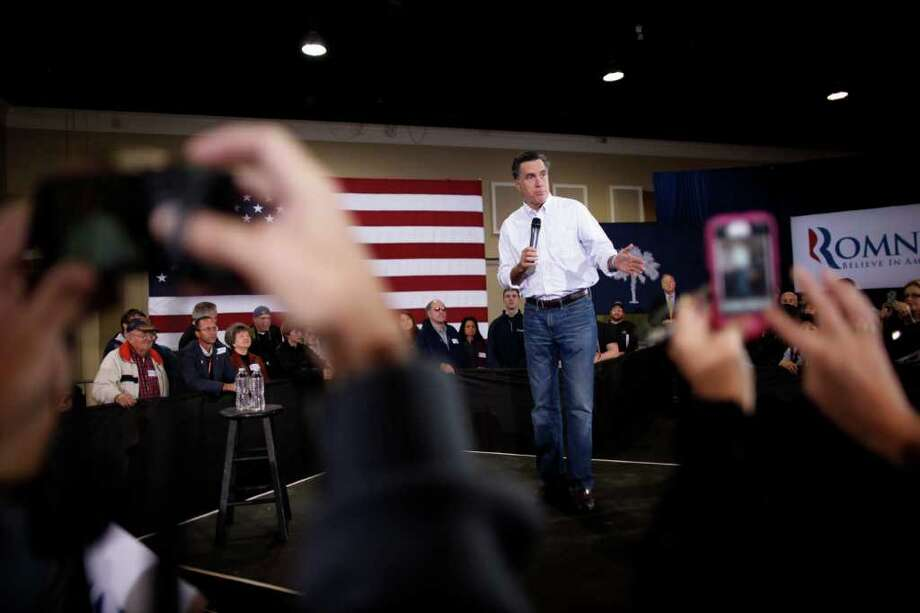 Republican presidential candidate, former Massachusetts Gov. Mitt Romney campaigns at the Florence Civic Center in Florence, S.C., Tuesday, Jan. 17, 2012. (AP Photo/Charles Dharapak) Photo: Charles Dharapak