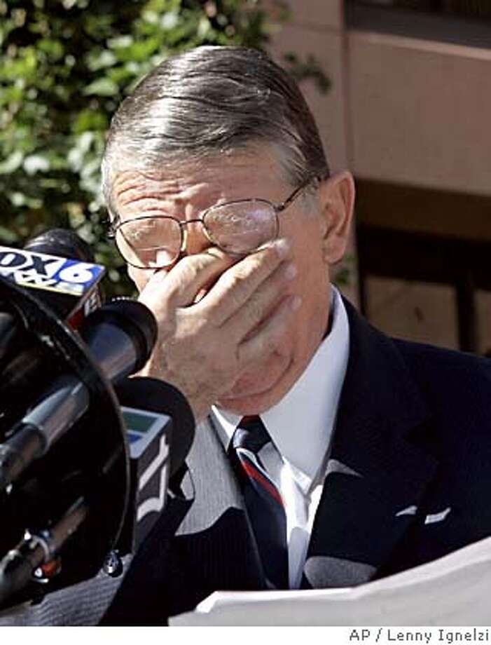 """Rep. Randy """"Duke"""" Cunningham, R-Calif., cries while reading a statement outside the federal courthouse in San Diego, Monday Nov. 28, 2005, after pleading guilty to bribery and admitting he took $2.4 million to steer defense contracts to conspirators using his leadership position on a congressional subcommittee. (AP Photo/Lenny Ignelzi) Photo: LENNY IGNELZI"""