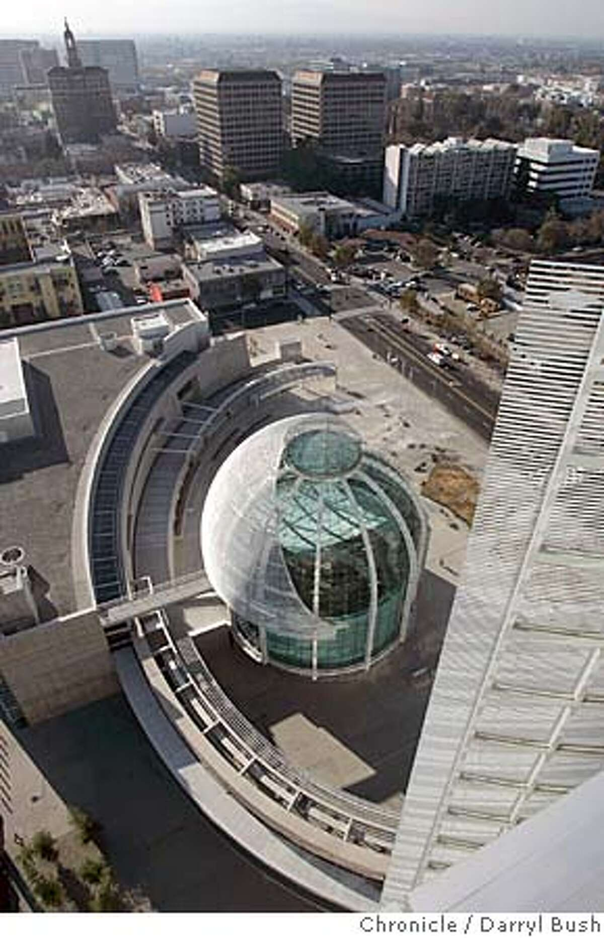 sanjosehall_0018_db.jpg View of the glass-domed rotunda from the top of the office tower showing the brise soleil (right) which shields the tower's west side from sun at the new downtown San Jose City Hall. Event on 11/23/05 in San Jose. Darryl Bush / The Chronicle MANDATORY CREDIT FOR PHOTOG AND SF CHRONICLE/ -MAGS OUT