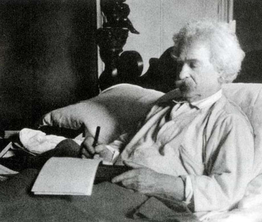 Mark Twain in bed, which he used as a second office in his later years