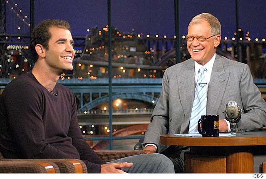 """Pete Sampras, who retired from tennis yesterday at the U.S. Open, shares a laugh with David Letterman during the taping of """"The Late Show with David Letterman,"""" on Tuesday, Aug. 26, 2003, in New York. Sampras, 32, leaves with 64 singles titles, including a record 14 at Grand Slam tournaments: seven at Wimbledon, five at the U.S. Open, and two at the Australian Open. (AP Photo/CBS, J.P. Filo) Photo: JP FILO"""