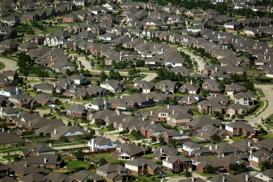 A new study finds more Houstonians are spending a higher percentage of their incomes on housing. Photo: Smiley N. Pool / © 2011  Houston Chronicle