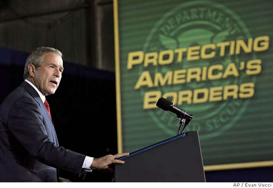 President Bush gestures during remarks about border security and immigration reform at Davis-Monthan Air Force Base on Monday, Nov. 28, 2005 in Tuscon, Ariz. (AP Photo/Evan Vucci) Photo: EVAN VUCCI