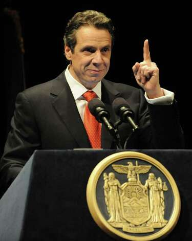 "New York State Governor Andrew Cuomo holds up his finger representing ""one government"" as he presents the 2012-2013 New York State budget proposal in the Hart Theater in The Egg on Tuesday, Jan 17, 2012 in Albany, N.Y.  (Lori Van Buren / Times Union) Photo: Lori Van Buren"