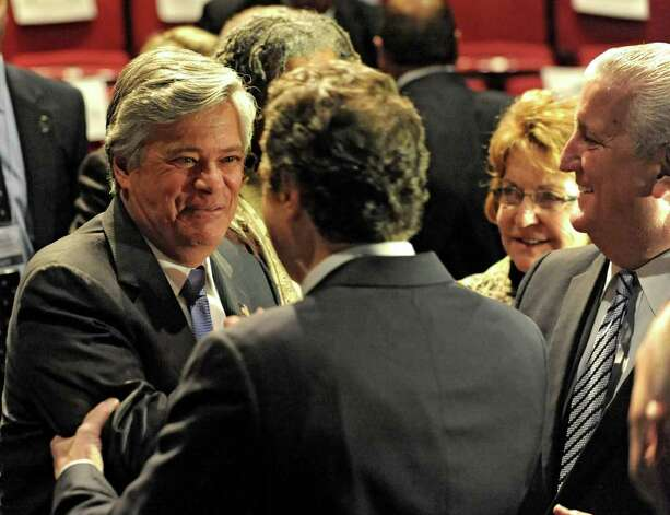 Senate Majority Leader Dean Skelos shakes hands with New York State Governor Andrew Cuomo following the Governor presenting the 2012-2013 New York State budget proposal in the Hart Theater in The Egg on Tuesday, Jan 17, 2012 in Albany, N.Y. Albany Mayor Jerry Jennings stands to the right.  (Lori Van Buren / Times Union) Photo: Lori Van Buren