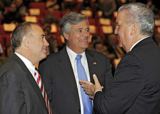 From left, State Comptroller Thomas P. DiNapoli, Senator Dean Skelos and Albany Mayor Jerry Jennings talk preceding New York State Governor Andrew Cuomo presenting the 2012-2013 New York State budget proposal in the Hart Theater in The Egg on Tuesday, Jan 17, 2012 in Albany, N.Y.   (Lori Van Buren / Times Union) Photo: Lori Van Buren