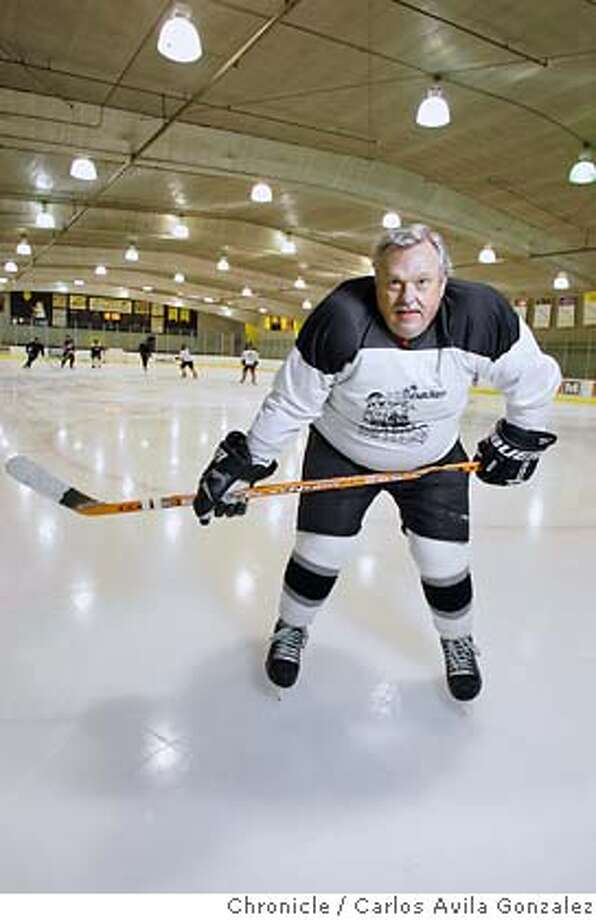 "Ron ""Fuzzy"" Freswick is a corporate pilot for Williams Sonoma who takes his hockey gear wherever he flies and finds pickup games. Freswick is 62 and grew up on the Canadian Prairie playing pond hockey. He plays in leagues Friday and Monday evenings at the Ice Oasis in Redwood City, Ca. He is pictured here at the ice rink on Thursday, November 3, 2005.  Photo by Carlos Avila Gonzalez/The San Francisco Chronicle  Photo taken on 11/3/05, in Redwood City, CA. Photo: Carlos Avila Gonzalez"